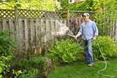 Man watering garden — Stock Photo