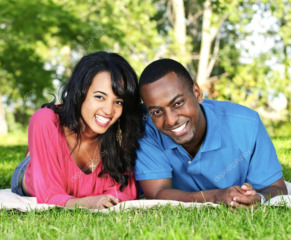 Young romantic couple enjoying summer day in park  Stock Photo #4718475