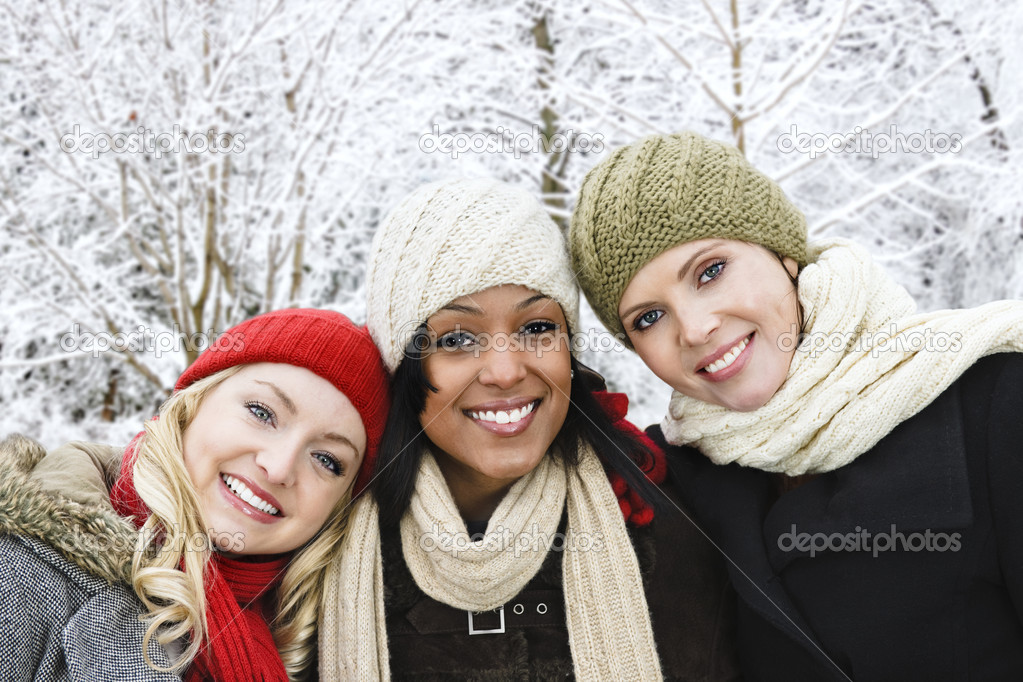 Group of three diverse young girl friends outdoors in winter — Stock Photo #4718564