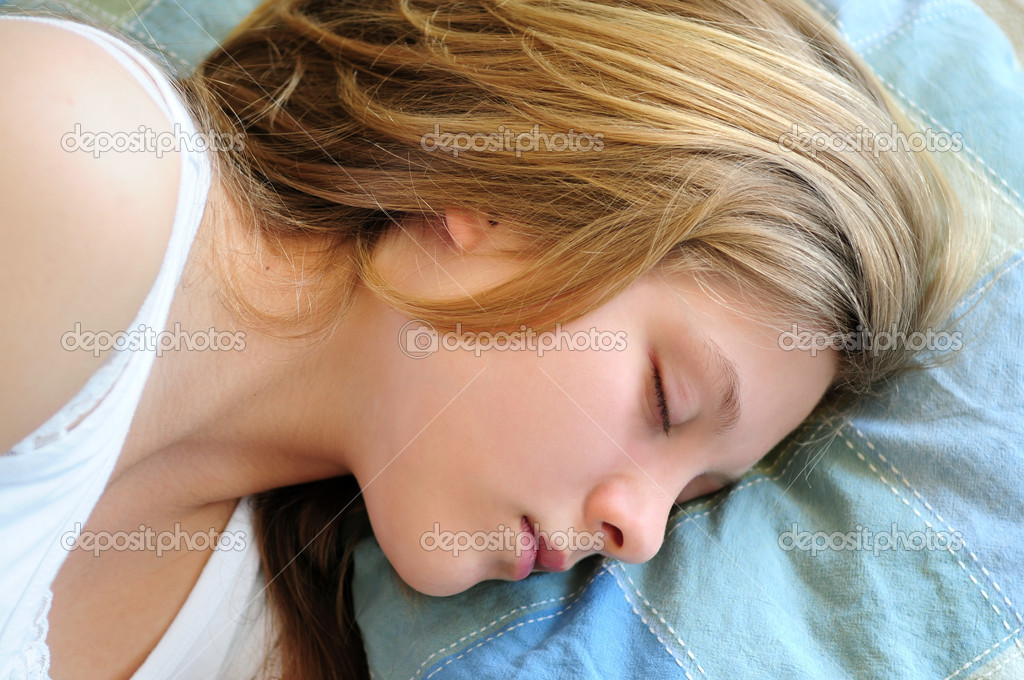 Beautiful teenage girl sleeping in the morning  Stock Photo #4718827