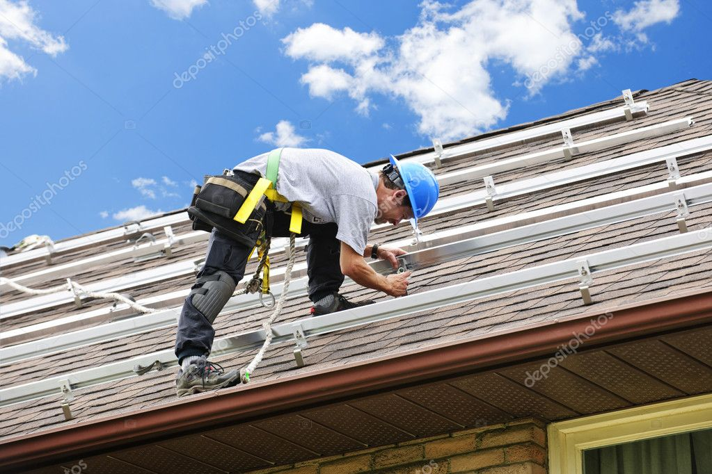 Man installing rails for solar panels on residential house roof — Stock Photo #4719467