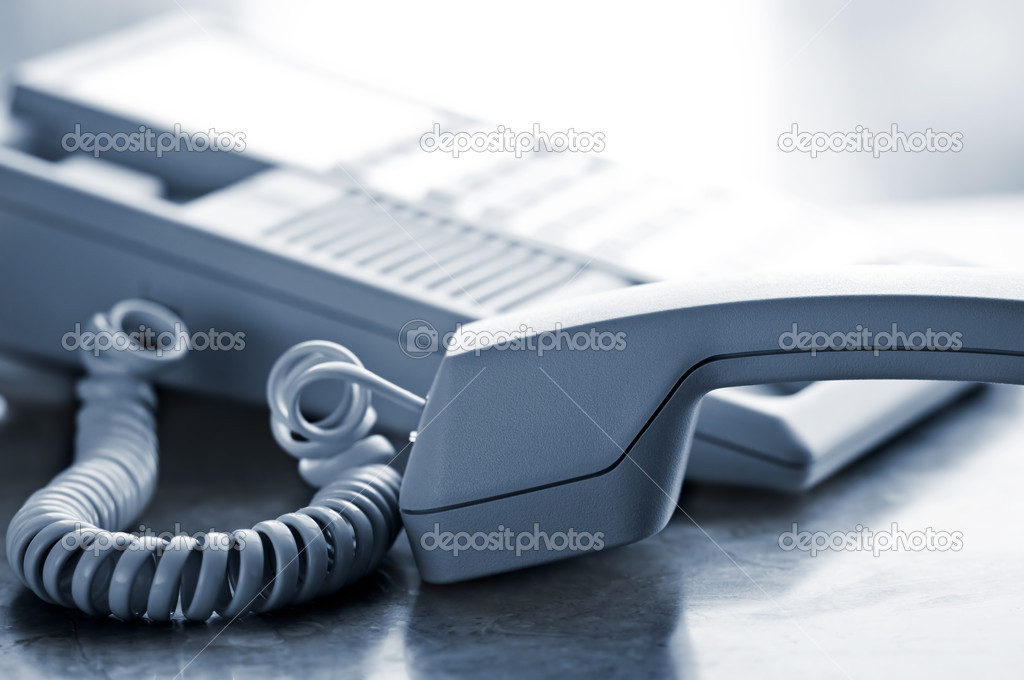 Telephone handset off the hook on desk — Stock Photo #4719587