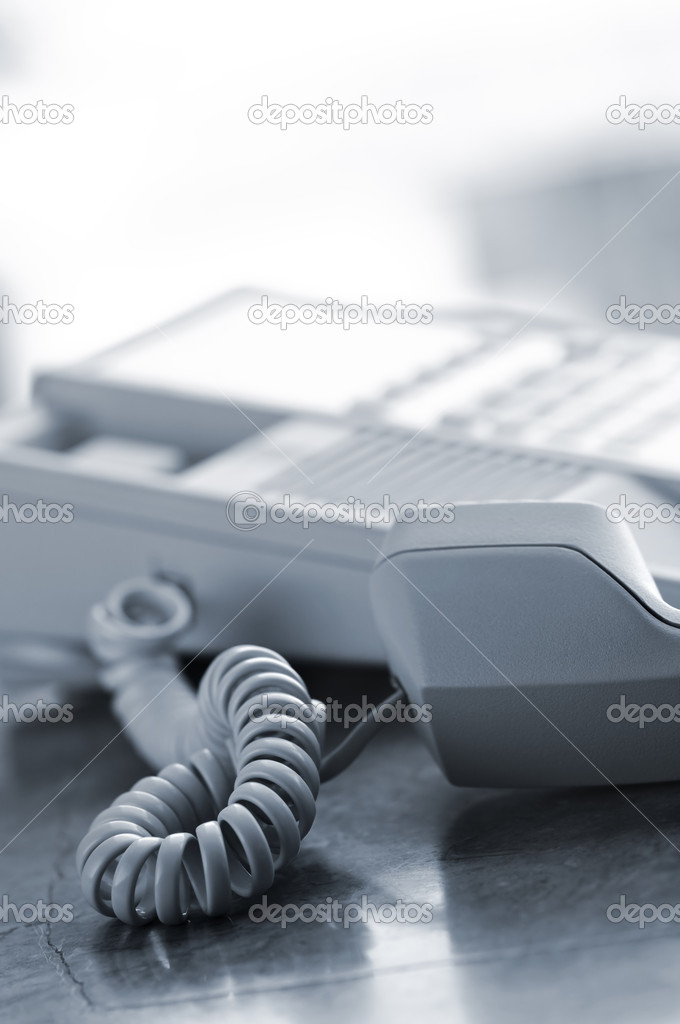 Telephone handset off the hook on desk  Stock Photo #4719589