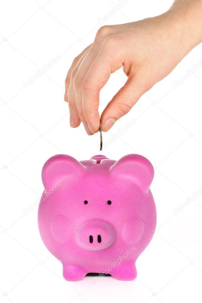 hand putting coin in piggy bank  u2014 stock photo