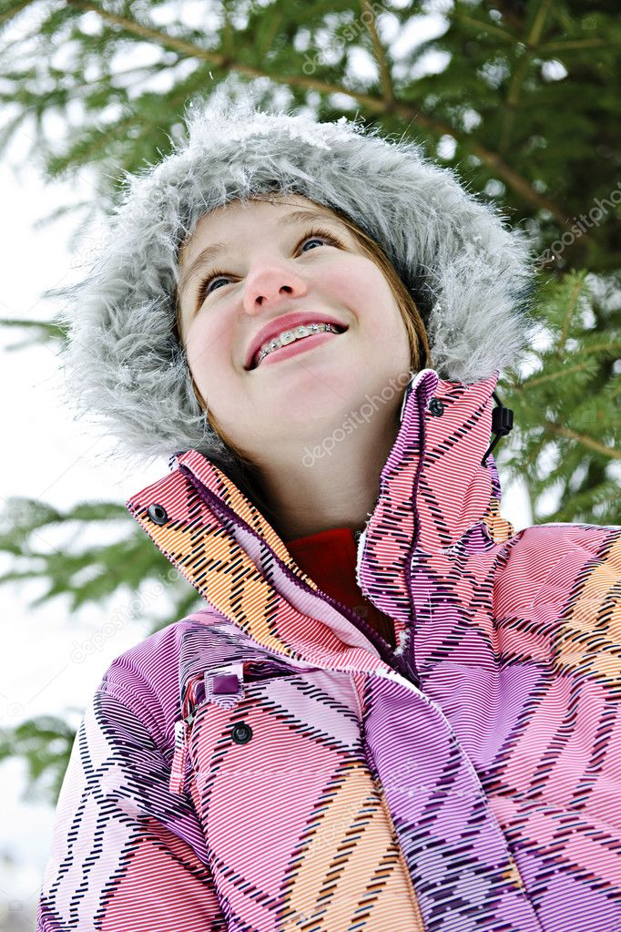 Portrait of happy teenage girl in winter ski jacket looking up — Stock Photo #4719601