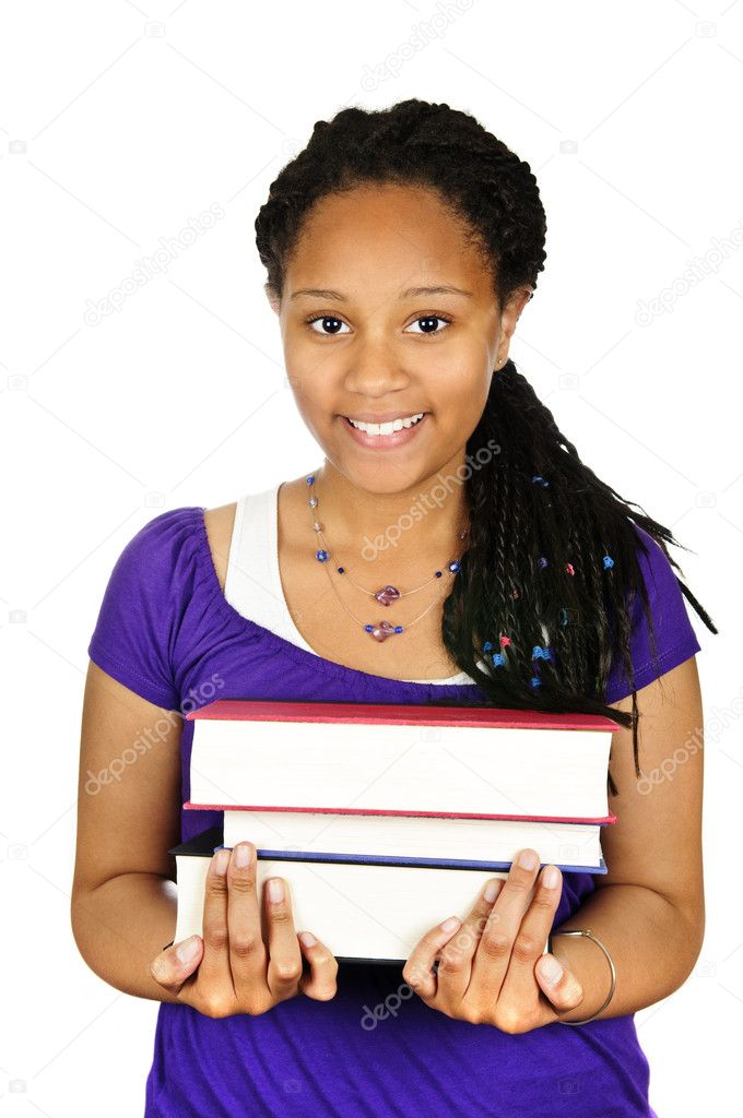 Isolated portrait of black teenage girl holding text books  Stock Photo #4719657