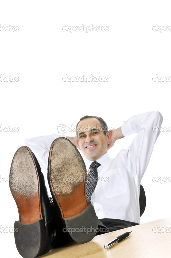 Relaxing businessman with feet up on his desk  Stock Photo #4719967