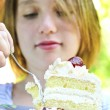 Girl eating a cake — Stock Photo #4720024