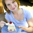 Girl eating a cake — Stock Photo