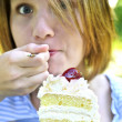 Girl eating a cake — Stock Photo #4720027