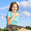 Young girl sitting on grass — Stock Photo #4720039