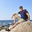 Hiker sitting on a rock — Stock Photo