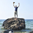 Man stranded on a rock in ocean — Stock Photo #4720070