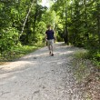 Man walking on forest trail — Stock Photo #4720087