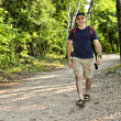 Man walking on forest trail — Stock Photo