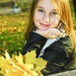 Teenage girl in the fall — Stock Photo