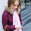 Stock Photo: Teenage girl text messaging on cell phone