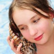 Young girl with seashell — Foto Stock
