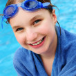 Teenage girl at swimming pool — Stock Photo