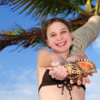 Young girl with seashell — Stock Photo