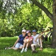 Family resting in a park - Stock Photo