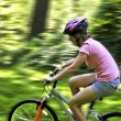 Teenage girl on a bicycle — Stock Photo #4720190