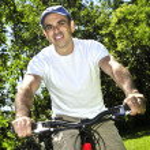Man riding a bicycle — Stock Photo