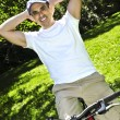 Man riding a bicycle - Stock Photo