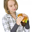 Teenage girl holding big hamburger — Stock Photo #4720294