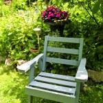 Chair in green garden — Stock Photo #4720389
