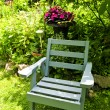 Chair in green garden — Stock Photo