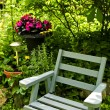 Chair in green garden - Stockfoto