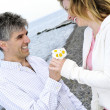 Stock Photo: Mature romantic couple with flowers