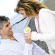 Mature romantic couple with flowers — Stock Photo