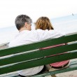 Mature romantic couple on a bench — Stock Photo #4720501