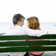Mature romantic couple on a bench — Stock Photo #4720504