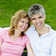Mature romantic couple on a bench — Stock Photo #4720510
