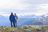 Hikers in mountains — Stock Photo