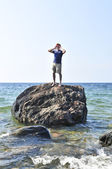 Man stranded on a rock in ocean — Stock Photo