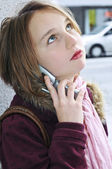 Teenage girl talking on cell phone — Stock Photo