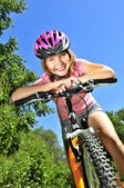 Teenage girl on a bicycle — Stock Photo