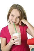 Teenage girl with milkshake — Stock Photo