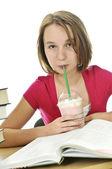 Teenage girl with milkshake — Stock Photo