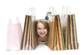Teenage girl with shopping bags — Stock Photo