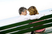 Mature romantic couple on a bench — Stock Photo