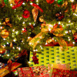 Gifts under Christmas tree — Stockfoto