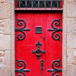 Red medieval door - Stock Photo