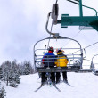 Skiers on chairlift - Stock Photo