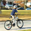 Stock Photo: Boy riding a bike