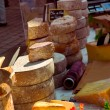 Cheeses on the market — Stok fotoğraf